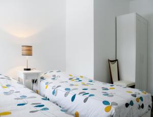 Un ou plusieurs lits dans un hébergement de l'établissement Gite de la Cour Basse