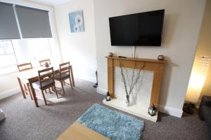 A television and/or entertainment center at 2 Bed House in Leeds