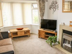 A television and/or entertainment center at Poets Retreat, Thornton-Cleveleys