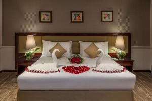 A bed or beds in a room at Boudl Abha