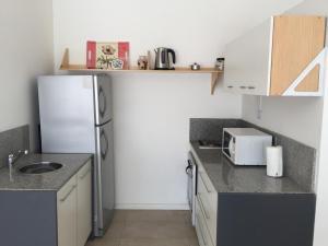 A kitchen or kitchenette at Pacheco Mono