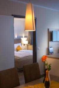 A bed or beds in a room at Cozy-Flats Koblenz