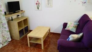 A seating area at Apartamento Bella Elena