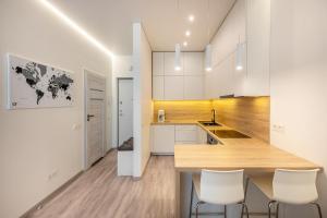 A kitchen or kitchenette at Subaciaus19