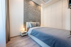 A bed or beds in a room at Subaciaus19