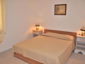 A bed or beds in a room at Locazione turistica Cinta