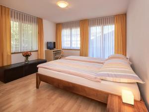 Ein Bett oder Betten in einem Zimmer der Unterkunft Haus Bor