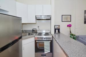 A kitchen or kitchenette at Times Square HighLine Two Bedroom