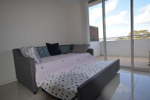 A bed or beds in a room at Large one bedroom in Burwood centre
