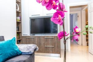 A television and/or entertainment center at Chic Apartments in the heart of Camden by City Stay London