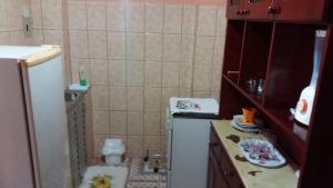 A bathroom at Apto Com Ar Px Doca