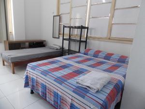 A bed or beds in a room at Lindo Apto Vista Ver O Peso