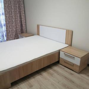 Кровать или кровати в номере Apartment on Kastanovaya 11