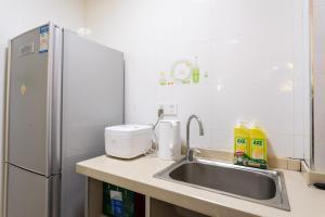 A kitchen or kitchenette at Wuhan Wuchang·Hubu Lane· Locals Apartment 00167580