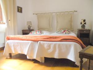 Un ou plusieurs lits dans un hébergement de l'établissement Au Bon Séjour