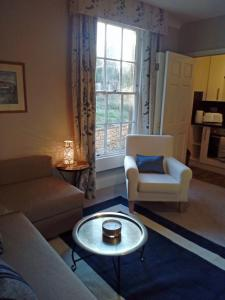 Zona de estar de The Apartment Balnain Villa