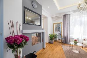 A television and/or entertainment center at Parliament Sofia - Top Center Luxury Apartment