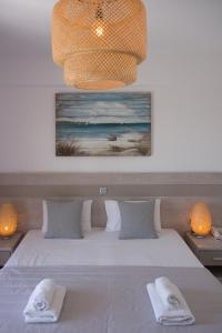 A bed or beds in a room at Alkinoos Beach Hotel