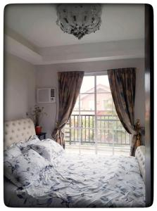 A bed or beds in a room at Bacolod House of Chandeliers