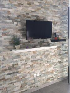 A television and/or entertainment center at Luckey Homes - Avenue Milon de Veraillon