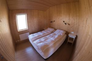 A bed or beds in a room at Myllulækur