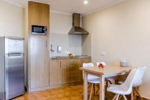 Cuina o zona de cuina de Apartamentos Blancala