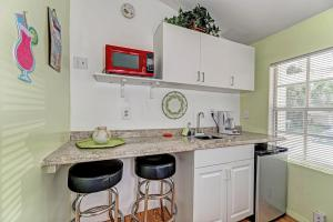 A kitchen or kitchenette at Inn At The Beach Units