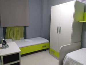 A bed or beds in a room at El Puente te está esperando
