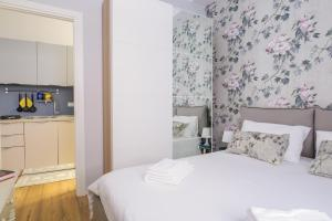 A bed or beds in a room at Cavour Apartment