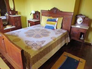 A bed or beds in a room at Casa São João