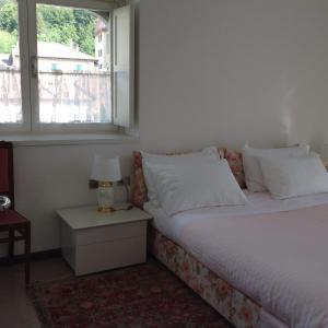 Letto o letti in una camera di Casa Mary Varenna