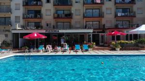The swimming pool at or near Payet Apartments