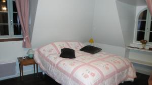Un ou plusieurs lits dans un hébergement de l'établissement Manoir de Moncan