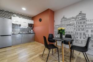 Кухня або міні-кухня у CITY Aparts