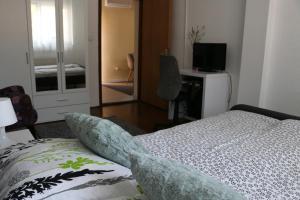 Vuode tai vuoteita majoituspaikassa Apartment Dunav