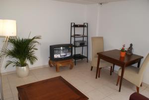 Een TV en/of entertainmentcenter bij Continentaiz Appartement