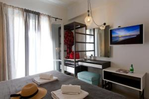 A television and/or entertainment center at LOC Hospitality Annunziata