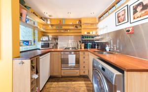 A kitchen or kitchenette at Artistic and Soulful Carnaby Street Movie Pad