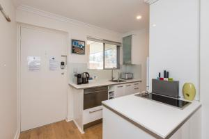 A kitchen or kitchenette at Cottesloe Beach Pines Apartment