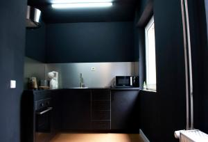 A kitchen or kitchenette at new design apartment