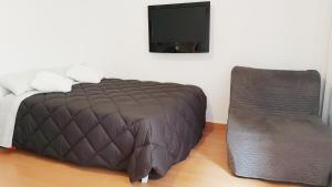 A bed or beds in a room at Alda Benalmadena