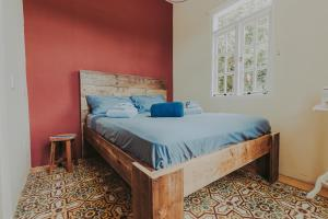 A bed or beds in a room at Monumental Landmark with Pool