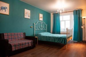 Кровать или кровати в номере ул. Кирова, 29