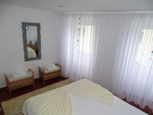 A bed or beds in a room at Balada dos Mares Vila