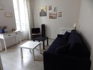 Coin salon dans l'établissement Apartment Centre Historique Bayeux