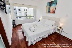 A bed or beds in a room at ALU Apartments - Miraflores Boardwalk