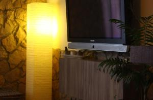 A television and/or entertainment center at Chões Mountain Spirit