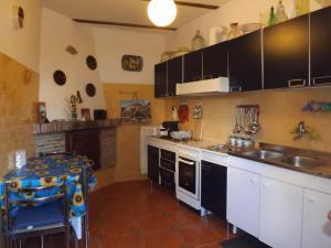A kitchen or kitchenette at Alloggio turistico Renato