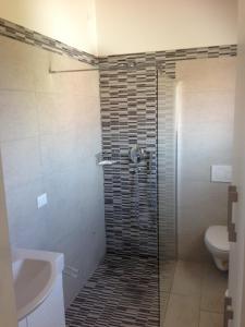 Koupelna v ubytování Villaggio Margherita