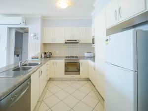 A kitchen or kitchenette at Glenelg Beachside Luxury Apartments
